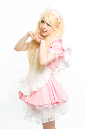 characterization: maid manga gesticulating in the studio, on white background Stock Photo
