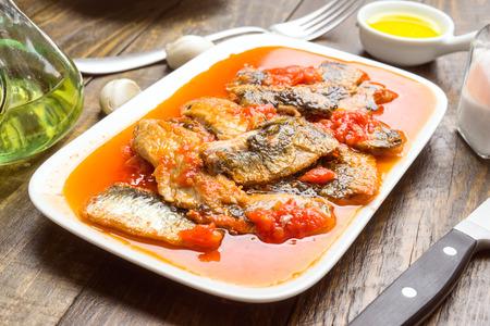 sardine fillets stewed with tomato sauce on wood