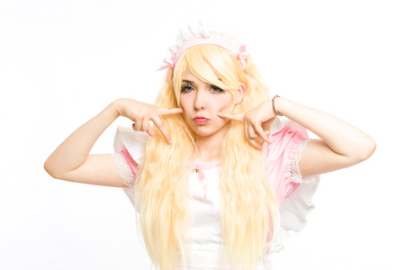 characterized maid manga girl makeup gesticulating in the studio, on white background