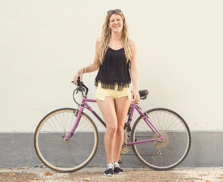 cheerfully: bicycle young girl with cheerfully laughs