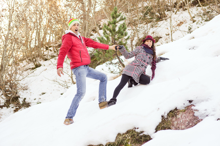 Couple walking in the snow in a forest glade