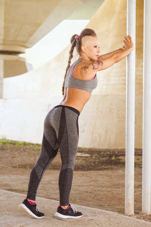 Gymnast heavy hipster posing while warms muscles