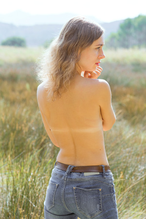 Natural girl half naked body in the field