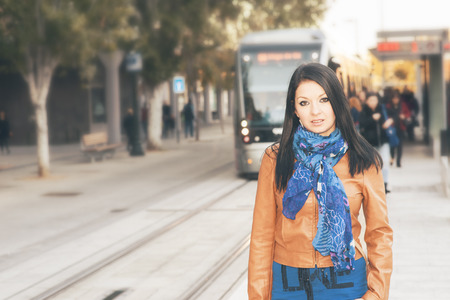 winter escape: Young woman travels through the city on a cold day Stock Photo