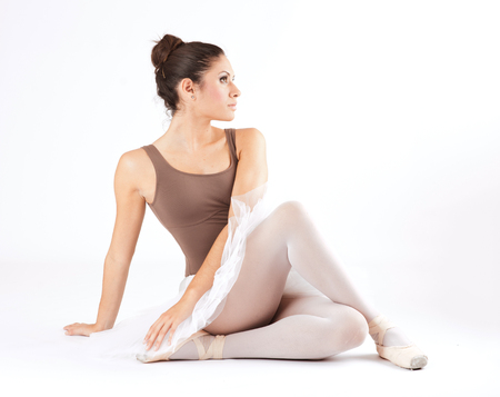 Young ballet dancer poses in studio on white background Stock Photo