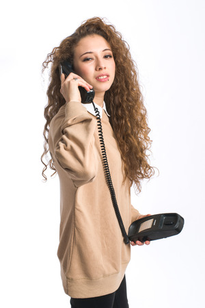Natural young girl on white background with classic phone