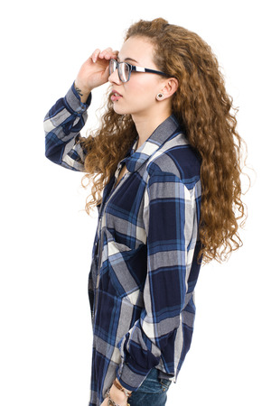 Young girl with glasses posing on white background;