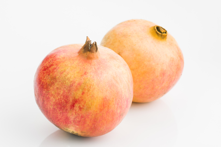 pomegranates isolated on white