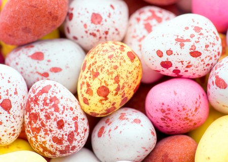 chocolates covered with mottled sugar speckled in colors Stock Photo