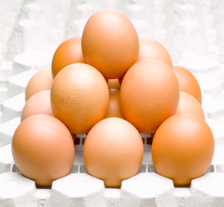 macro shot of a group of eggs forming a pyramid