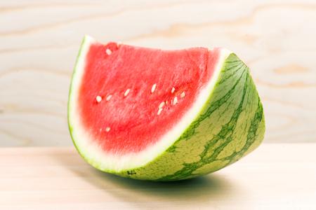 half watermelon on light wood
