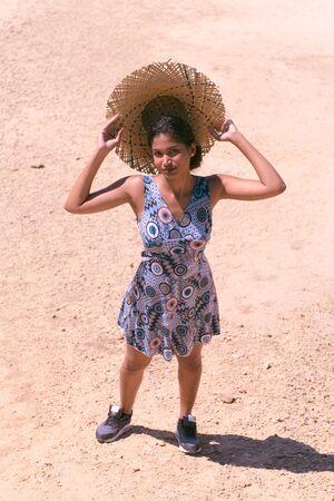 Young woman of Hindu origin visits the Bardenas Real de Navarra, Spain, natural reserve of the biosphere