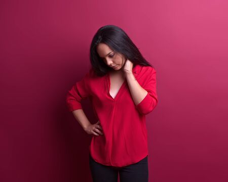 Thoughtful young girl in front of a red background