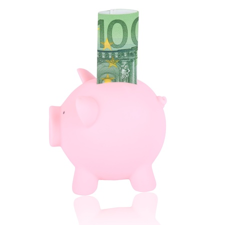 Pink piggy bank with 100 euro banknote on a white background. photo