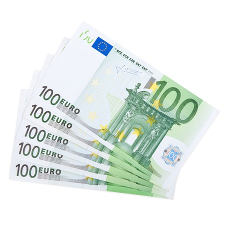 Close-up of 100 Euro banknotes isolated on white background.