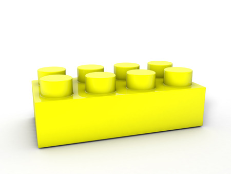 yellow lego block: Yellow lego block on a white backgroind. Stock Photo