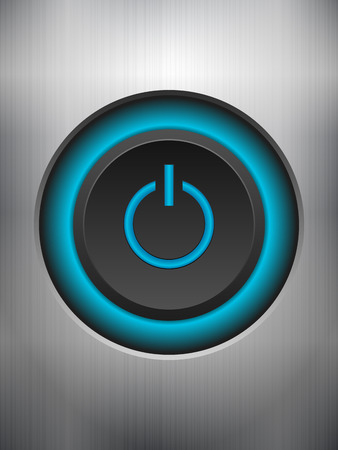 power button: Power button knob on a metal background.
