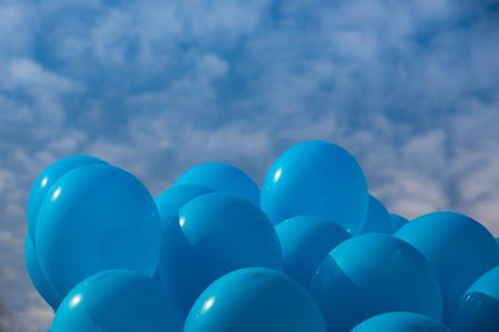 Blue helium ballon in the sky Stock Photo
