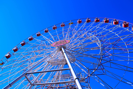 Minsk ferris wheel in central city park, Belarus. Ferris wheel against a blue sky.