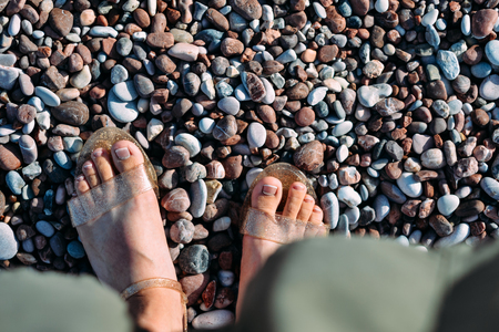 Feet in sandals at Pebble Beach