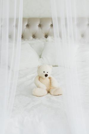 Teddy Bear lying in the bed. Teddy bear