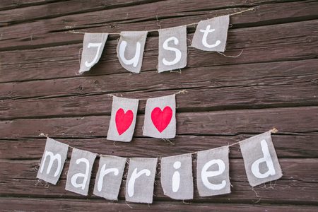 The inscription Just married the wooden walls. Rustic style