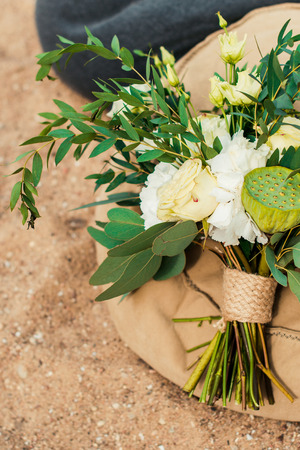 Wedding bouquet lay in the sand. Wedding on the beach Stock Photo