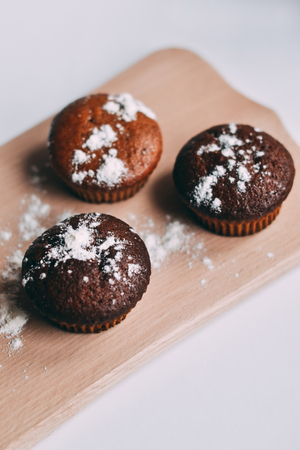Homemade delicious chocolate muffins close-up,vertical, top view