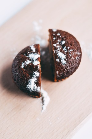 This is a close up shot of a muffin ripped in half. Shot with a shallow depth of field.