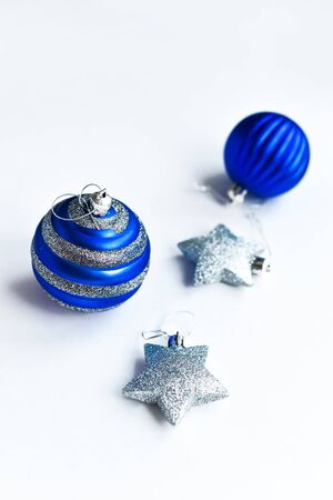Christmas composition. Christmas blue and silver decorations on white background Standard-Bild
