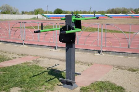 The simulator for swinging the press by lifting the legs. Sports camp at the stadium. Archivio Fotografico
