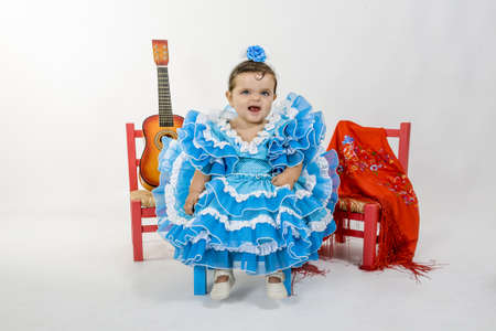 a baby dressed in flamenca dress