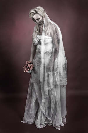 is a zombie dressed in a wedding dress photo