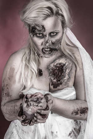 is a zombie wearing a wedding dress with hand on heart photo