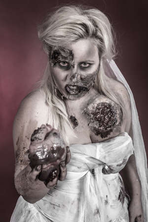 is a zombie wearing a wedding dress with hand on heart Stock Photo - 18767643