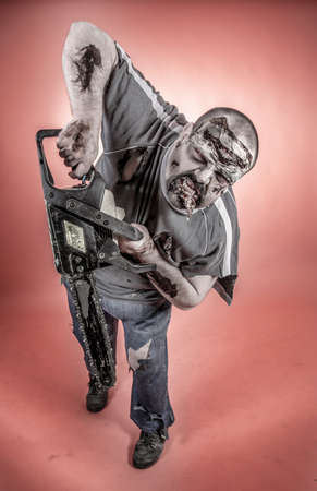 is a man disguised as a zombie one with mechanical saw