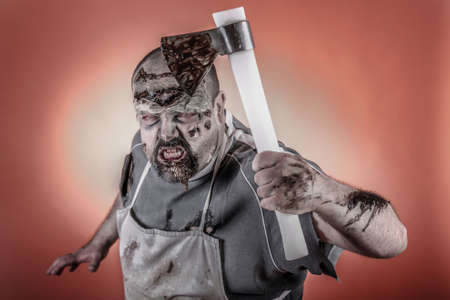 is a man dressed zombie one with butcher knives and axes