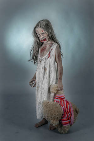 creepy hand: is a zombie girl dressed in a nightgown