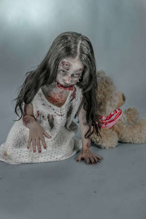 is a zombie girl dressed in a nightgown photo