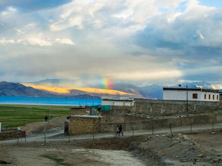 Tso Moriri Lake near Karzok Village with beautiful mountain and rainbow Stock Photo