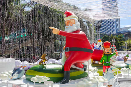 Bangkok, Thailand : December 3, 2017  Christmas Decoration with Christmas Tree, Santa Claus Sculpture, Reindeer and other cartoon characters in front of Central World Shopping Center