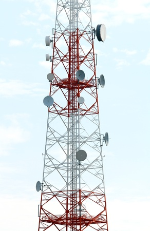 Mobile phone mast antenna on blue sky background photo