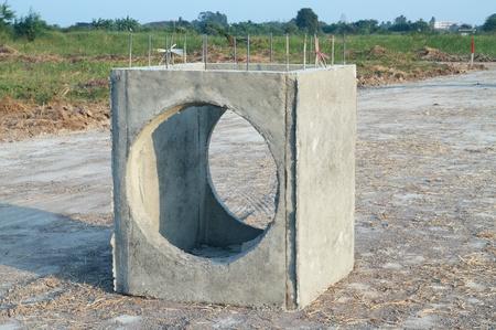 Concrete drainage tank on construction site  photo
