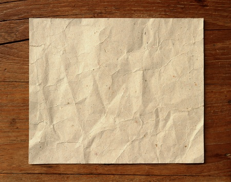 Crumpled paper on wooden background Stock Photo