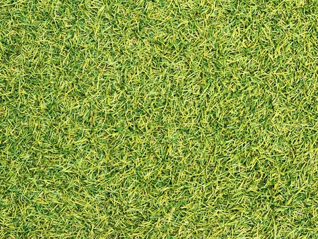 Green artificial grass texture background photo
