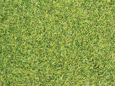 pasto sintetico: Verde césped artificial textura de fondo Foto de archivo