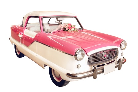 Vintage car decorated for wedding isolated on white background