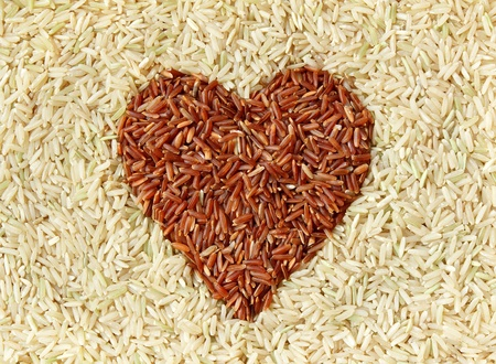 rice grains: Brown rice and red rice with heart shape texture background