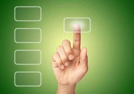 Hand pushing screen button photo