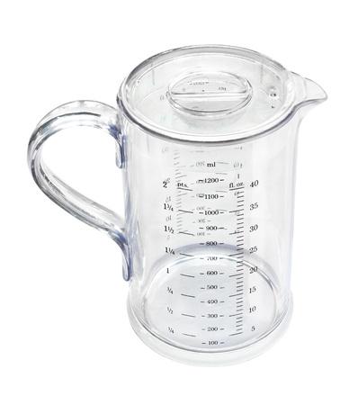Measuring transparent jug isolated on white background